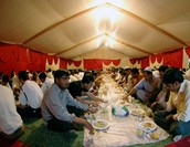 A large group of Muslims breaking their long fast during the month of Ramadan.