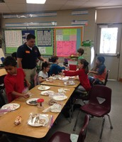 Parents helping our students in Mrs. Whitley's class.