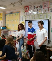 Bea, Dani, and Max discuss poetry with First Grade
