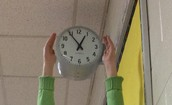 """Holding"" the Clock"