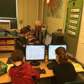 Third graders working on their research writing.