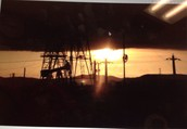 Oil drilling at the sunset