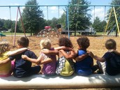 Kinders enjoying mulch delivery