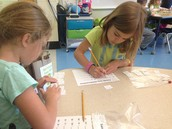 Bella and Grace counting their manipulatives.