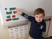 Kellan is reading and recognizing sight words with Y.
