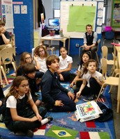 Fourth Graders listening to a high school visitor