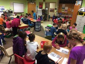 STUDEN COLLABORATION:  Cari's 4th graders teach Ralene's 1st graders how to take notes.