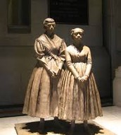 Statue of her and one of her Black Students