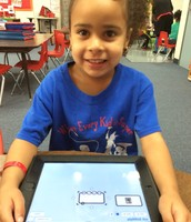 Student adds pictures to popplet lite
