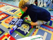 Henry building his Brain Book words with blocks and rods...these help kiddos build from left to right