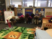 The kids taking a bow after acting out a story!