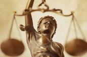 What are some flaws in the judicial system that the media has brought to the public?