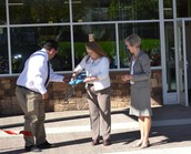 Ribbon cutting for two schools