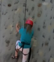Jersee begins her climb up the wall!