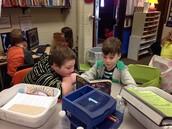 Josh and Ivan enjoy Read to Someone.
