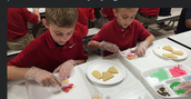 2nd & 6th grade again decorate cookies for Advent project