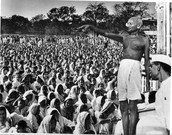 Gandhi leading a speech to gain Indian Independence