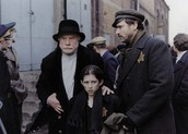 alex, his father ans boruch in the movie