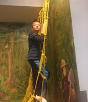 Brian is King of the Mountain at the Adventure Center- YMCA