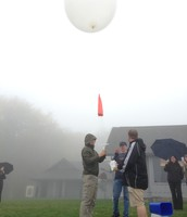 Ms. Ingle and Ms. Zunguze join a team of Buncombe County teachers to launch a weather balloon over the Smoky Mountains with a UNCA meteorologist.