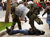 Policeman Kicks Person on the Ground