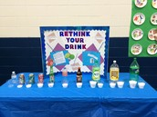 the 6th and7th made a poster and visual of how much sugar is in different drinks