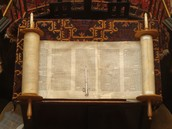 A picture of a Jewish Torah which is the holy book (or scroll) of Judaism