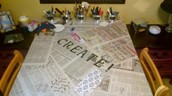 Table Covered In Newspaper For Art Project