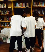 Fourth Grade picking up their books.