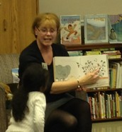 Beth Will reads with eager students