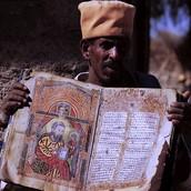 A man with an Axum religious book