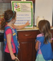 Buddies teaching the Girl Scout Promise and Law