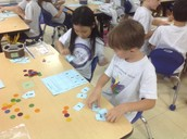 Mina and Charles - Comparing 3-Digit Numbers