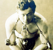 An infamous photo of Houdini in one of his traps.