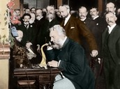 Alexander Graham Bell talking in the phone