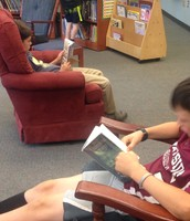 Andrew and Sebastian steal a few moments of peaceful reading!