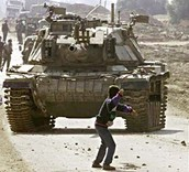Palestinian kid taunting an Israeli tank (I don't know why he would do that)