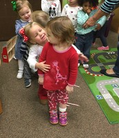 Hugs for a friend while lining up to do the candy cane hop...