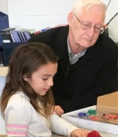 Olivia teaches her grandfather about circuits