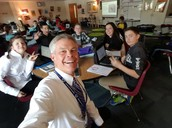 Selfie while writing with the 7th graders