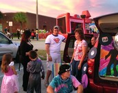 30 Decorated Cars with Candy Line the Trunk or Treat midway