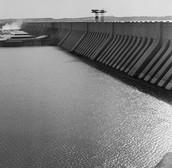 What are the positives and negatives of the Aswan Dam?