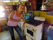 Laura, happy to get her new stove