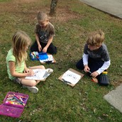 Group work outside on our warm day - Collaboration is a key piece to gaining understanding!