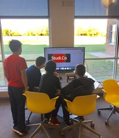 Students working on a mini capstone project in Computer Science Principles