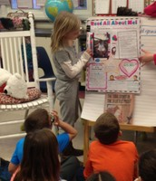 Stella sharing her Student of the Week Poster