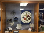 Thank you Mrs. Brown for beautifying our trophy cases!