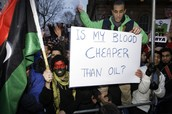Libyans holding signs against Muammar