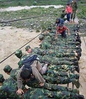 Soldiers and Rescuers acting as bridges for people to cross the disaster