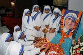 other nuns at the convent honoring Mother Teresa after her death.